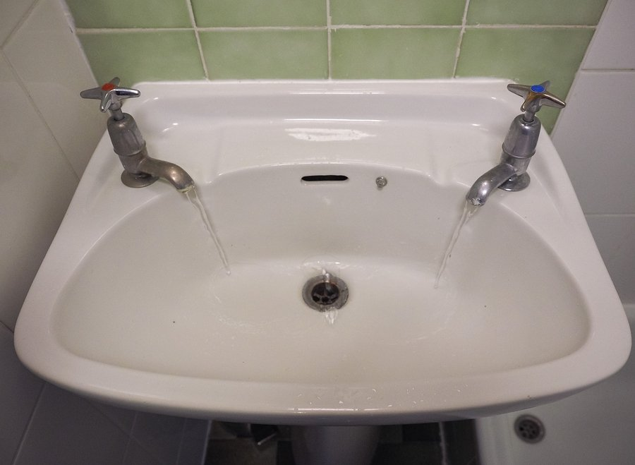water basin with separate hot and cold water taps as used in Britain