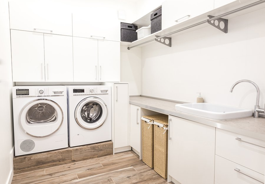 Laundry room in modern style with wasing and drying machine