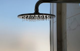 Luxurious hotel shower with mounted metalic shower head